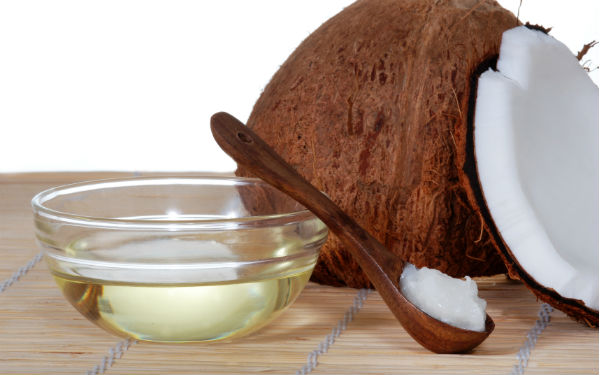 Coconut Oil Thousands of people swear by Coconut Oil as something that will not only cure your dandruff, but it leaves your hair smelling great too! Massage 4 Tablespoons of it on your scalp and let it set for an hour. Shampoo normally and repeat several times a week.