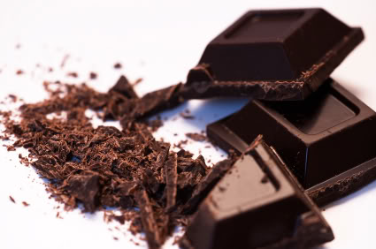 Dark Chocolate I am not talking about Hershey's candy bars. I am talking about dark chocolate which is at least 70% cocoa. Not only does dark chocolate enhance your mood and make you feel younger, it protects your skin. A recent study showed that women who ate just 20g of dark chocolate daily their skin resisted the damage by UV rays. Most of the signs of aging in the skin comes from UV ray damage. It is high in antioxidants as well which also fights free radical damage to the skin. Just remember to only eat dark chocolate and no more than one small square daily. Eating too much of it can do more harm than good!