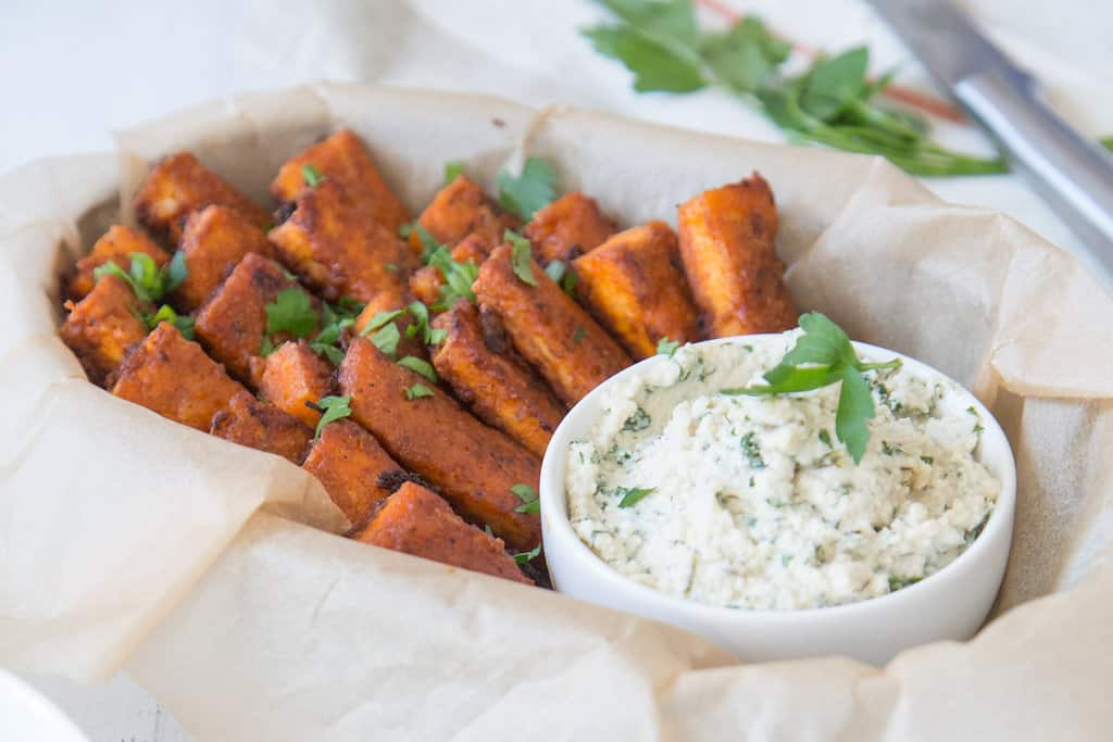 tofu pressed with EZ tofu press in buffalo hot sauce with ranch dressing