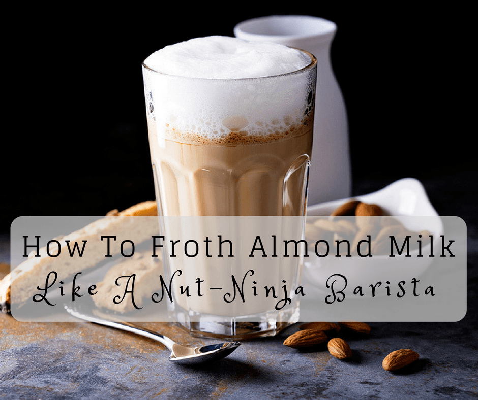 almond milk with froth and almons with a spoon