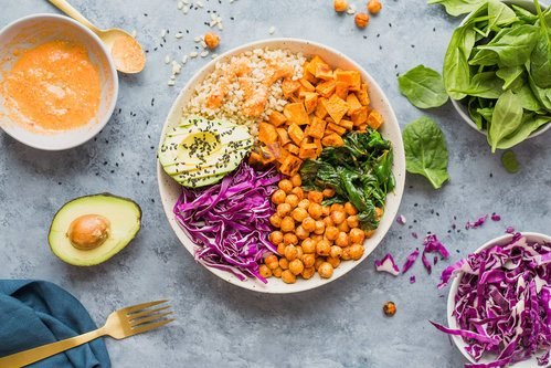 vegan buddha bowl with chickpeas, sweet potato and cabbage shredded with made with spiralizer vegetable slicer