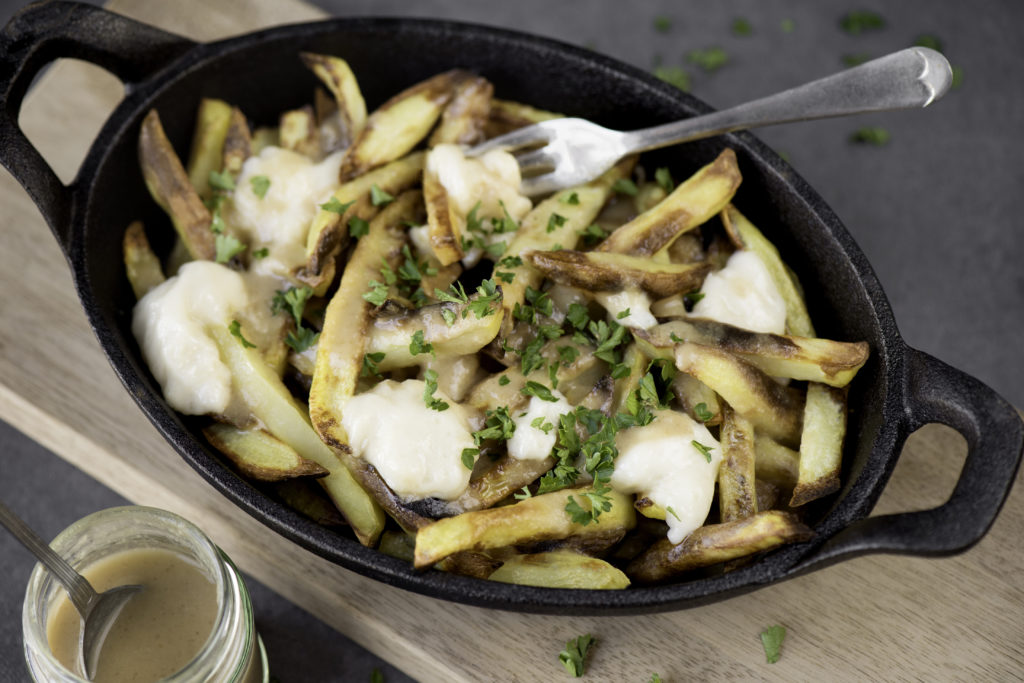 vegan poutine in a cast iron skillet